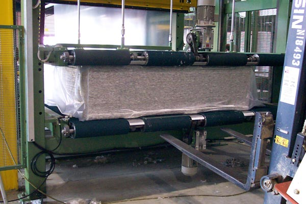 Compressive wrapping machines